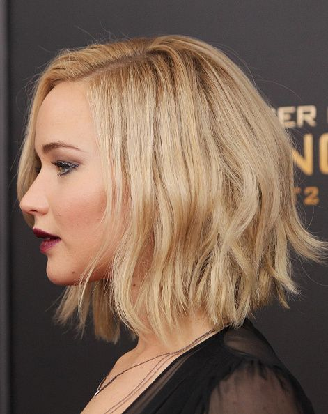 Actress Jennifer Lawrence hair detail attends the 'The Hunger Games Mockingjay…