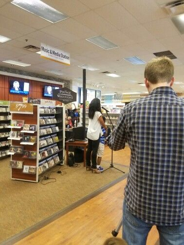 """Addressing the crowd at LifeWay Christian Book Store, Greeting them and telling all about the book she was doing the book signing for...""""The Prince Warriors""""."""