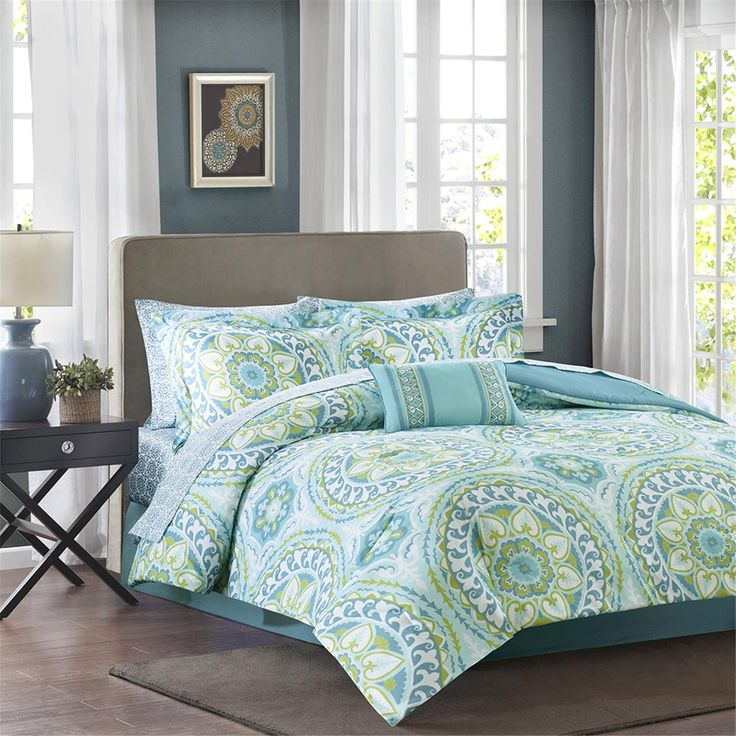 For a modern update to your space, the Madison Park Essentials Serenity Complete Bed and Sheet Set can provide a whole new look with fun colors. An intricate medallion pattern repeats across the top of bed with shades of teal, green and blue playing up this oversized print. An oblong pillow uses decorative embroidery and piecing to create texture on the top of bed while 180 thread count cotton sheets feature a blue medallion print to complete this look.