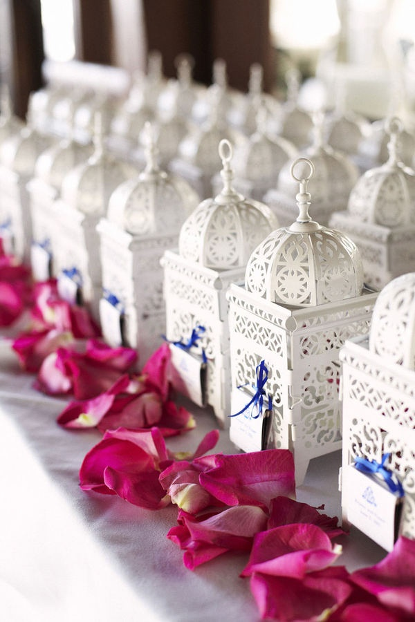 little white moroccan lanterns as gifts + a line of rose petals