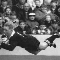 All Black winger Jeff Wilson scores one of his three tries on his test debut against Scotland at Murrayfield in 1993. Photo by the New Ze...