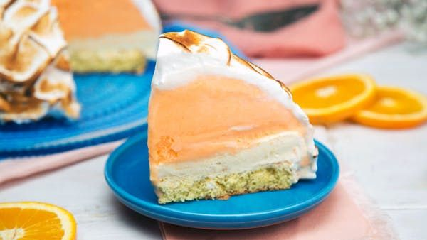 Recipe with video instructions: Made with orange juice and zest, this sweet baked Alaska is a citrus lover's dream dessert. Ingredients: Cake layer:, 2 eggs, 3 Tbsp water, ½ tsp vanilla extract, 1 Tbsp orange zest, ½ cup sugar, ⅔ cup cake flour, ½ tsp baking powder, ⅛ tsp salt, Ice cream layers:, 1 ½ quarts orange sherbet, softened, 2 pints vanilla ice cream, softened, ¼ cup orange juice concentrate, defrosted, 3 Tbsp orange zest, Meringue layer:, 7 egg whites, ¼ tsp cream of tartar, 1 cu...