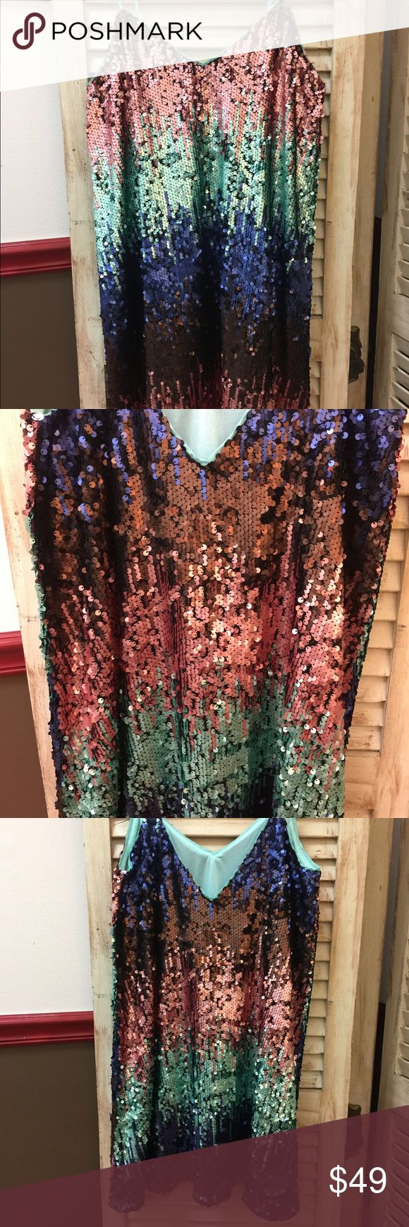Sequin Dress Multi Color Sequin Dress with spaghetti straps & inner lining. Small 4-6, Medium 7-9, & Large 10-12. Dresses Midi