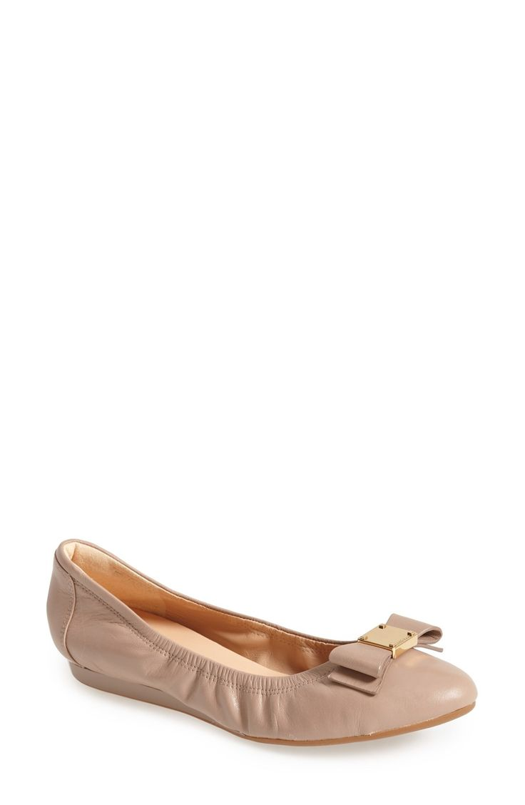 Free shipping and returns on Cole Haan 'Tali' Bow Ballet Flat (Women) at Fashiondoxy.com. A sleek bow accented with logo-embossed goldtone hardware puts a modern twist on a signature leather ballet flat that features a supportive micro-wedge and a padded