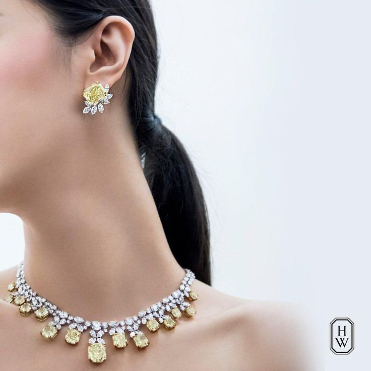 Harry Winston.  Rare yellow and white diamond wonders effortlessly float against the wearer in this impressive suite of Harry Winston