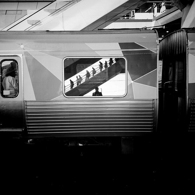 """Of all the 114 photos I've posted on my Flickr account in 2015, this one attracted the most """"faves"""". The escalator shot, reflected in the window of a passing train, happened by coincidence as I was glancing up and noticing the people descending to the platform. Luckily I had my phone ready at hand. It also happens to be an unintended selfie."""