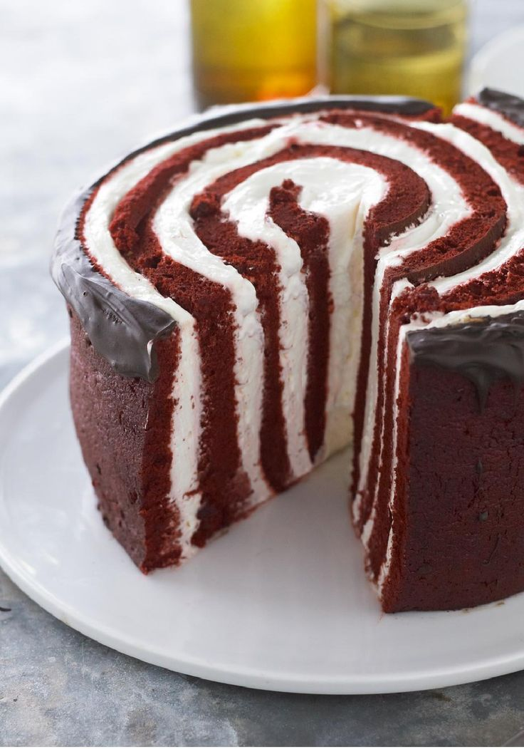 Under-a-Spell Red Devil Cake — Cream cheese, COOL WHIP, and white chocolate pudding mix combine to create the white frosting swirl that is surrounded by a moist and velvety chocolate cake.