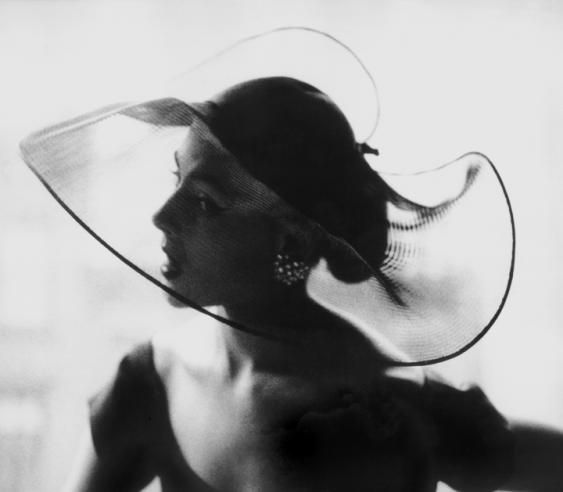 theniftyfifties:  Model in a translucent hat, 1950. Photo by Lillian Bassman.