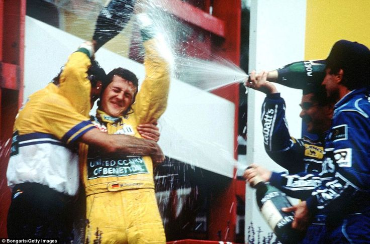 That's my boy! Benetton boss Flavio Briatore gives Michael Schumacher a hug after the German's first ever Formula One victory at the 1992 Belgian Grand Prix, where he is soaked with champagne on the podium by Williams duo Riccardo Patrese (right) and Nigel Mansell. The win came a year after Schumacher had made his debut in the sport with Jordan at the very same race circuit in Spa-Francorchamps