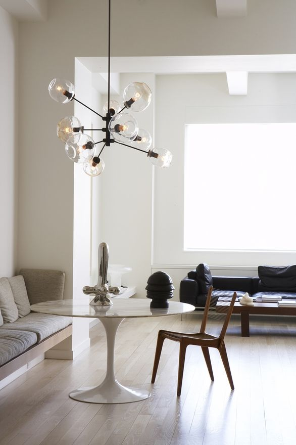 Yet another fab light...I also like mixing the banquet, the Tulip table and a great chair referencing Danish design...
