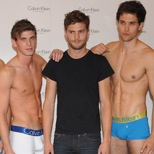 http://www.eonline.com/news/622918/fifty-shades-flashback-see-jamie-dornan-s-awkward-photo-with-7-nearly-naked-male-underwear-models