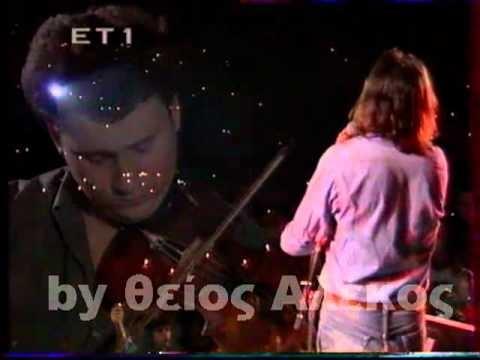 ΝΙΚΟΣ ΠΑΠΑΖΟΓΛΟΥ - Αύγουστος    Απο την συναυλία που δόθηκε στο Θέατρο Λυκαβηττού στις  30 Σεπτεβρίου 1991 και μεταδόθηκε απο την ΕΤ1