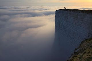 Stand above the clouds. Beachy Head, England.