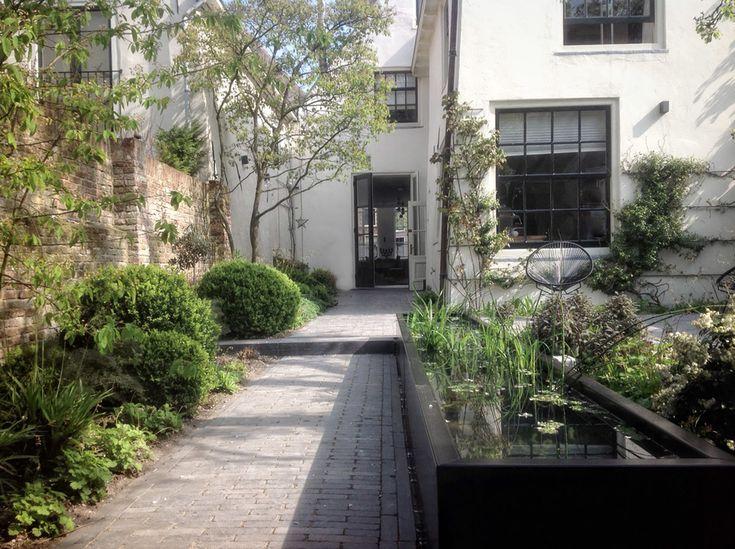 patio city garden with black steel pond