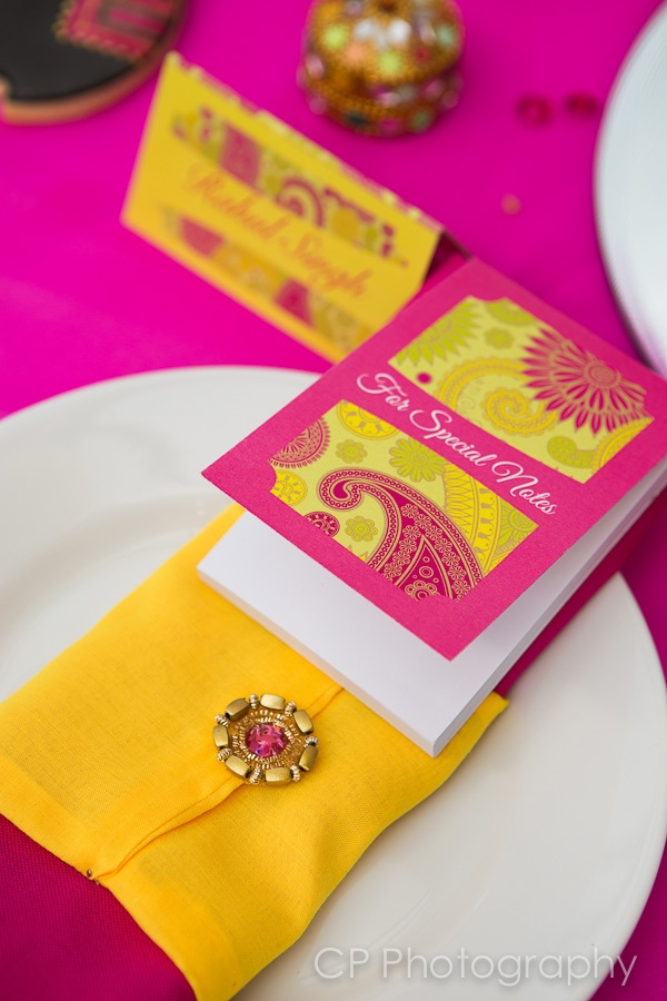 Bombay Mix from Fuschia's Asian Dreams wedding and celebration collection. Matching note books makes great favours and gifts for your guests to take home.  Add a splash of colour with coloured linen napkins with our jewelled napkin wraps all available for hire. By www.fuschiadesigns.co.uk