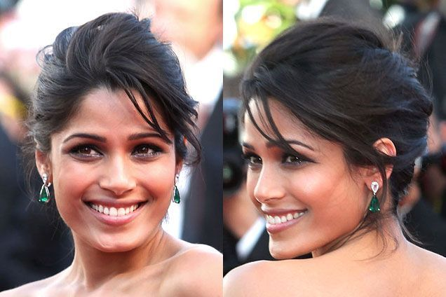 Frieda Pinto effortless, messy, roughed-up French twist with piecey bangs and glitter eyeliner | allure.com