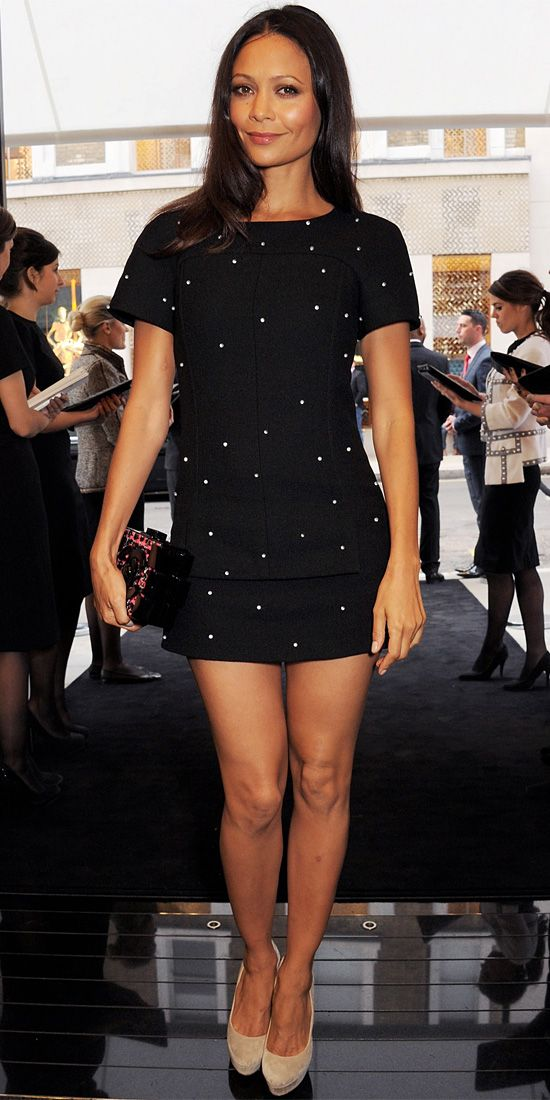 Newton bared endless legs in a darling polka dot Chanel LBD. A boxed clutch and gray pumps completed the look.