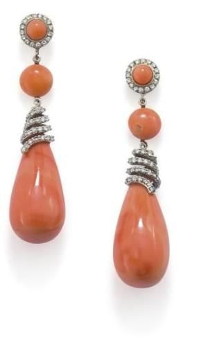 A pair of coral and diamond ear pendants  Each designed as coral drops set with a brilliant-cut diamond spiral cap, suspended from a cabochon coral spacer, to a coral and circular-cut diamond surmount, length 4.5 cm, post fittings. by hester