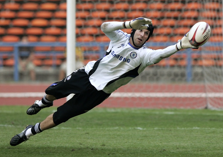 Petr Cech - (Czech) despite his headgear he's one of the best in the world. Not sure what he's doing saving a rugby ball, but he is typically found playing soccer/football for Chelsea.