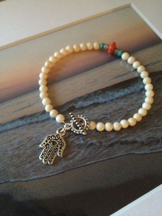 Such a cool Hamsa charm. Turquoise and Coral Hamsa Toggle Bracelet on Etsy, $20.00 exclusively at the Artsy Nomad shop on Etsy www.theArtsyNomad.etsy.com #hamsa #jewelry #beachstyle