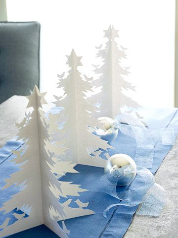 A forest of festive white paper trees