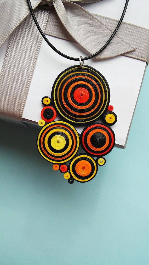 Colorful Paper Quilling Necklace Paper, non-toxic glue and lacquer, string of cotton weave, silver fastener. Real size: Length 5 Centimeters (1,97 inches) Width 3,5 Centimeters (1,37 inches) Thickness 0,2 Centimeters (0,08 inches) When you purchase a Necklace it can be minimal differ from the picture. What is Quilling: Quilling or paper filigree is an art form that involves the use of strips of paper that are rolled, shaped and glued together to create decorative designs.