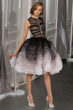 this dress shows rhythm through gradation and the repeating ruffles and zebra stripes.