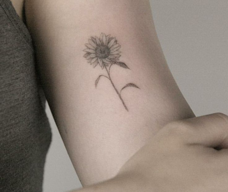 Dainty sunflower tattoo