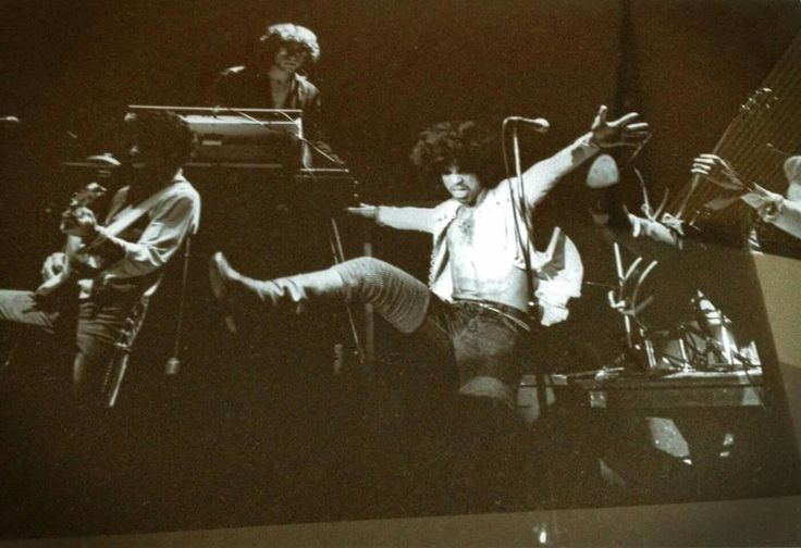 Prince performing with his first backing band at The Capri Theater in Minneapolis January 5th 1979 one year after signing his record deal with Warner Brothers Records in 1978. L to R, Andre' Cymone (Bass) Matt Fink (Keyboards and vocals) Prince and Dez Dickerson (Guitar and  vocals) Bobby Z. (Drums) and Gayle Chapman (Keyboards and vocals) are not included in this photo. #Enlight