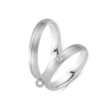 Γαμήλιες βέρες CHRILIA 35 σε ματ λευκόχρυσο με μία διαγώνια λωρίδα και ένα μπριγιάν για τη σύζυγο | Κοσμηματοπωλείο ΤΣΑΛΔΑΡΗΣ στο Χαλάνδρι #βερες #γάμου #wedding #rings #Chrilia #tsaldaris