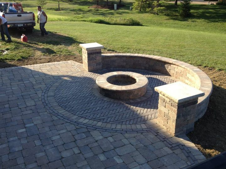 Paver Patio -- really like the half arch wall around firepit