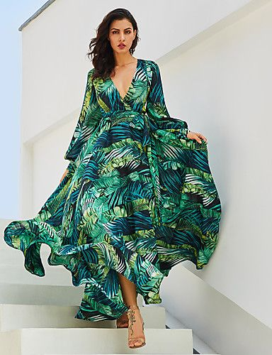 89c42b10a43 This tropical maxi dress is perfect for your next vacay. It s a glam style  that features a green palm print. The V-neck is a sexy plunging design.