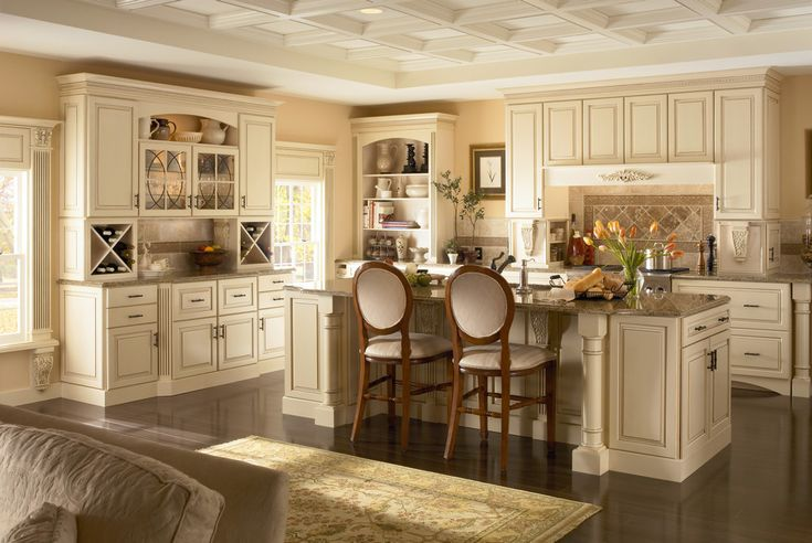 Elegance meets functionality with base pull-out drawers and hidden pantries, an island with extra storage and a matching hutch for linens and wine.