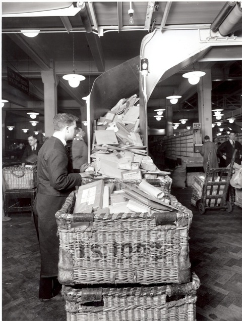 :::::::::: VIntage Photograph ::::::::::  Postman working package conveyor belt.  Mount Pleasant Post Office 1934