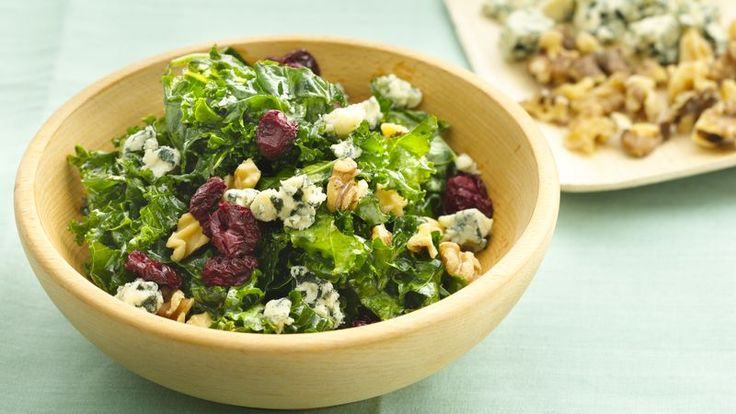 Massaging kale means to rub the leaves with a bit of olive oil, lemon juice and salt. This makes this fiberous green much more tender and palatable and makes this salad delightful.