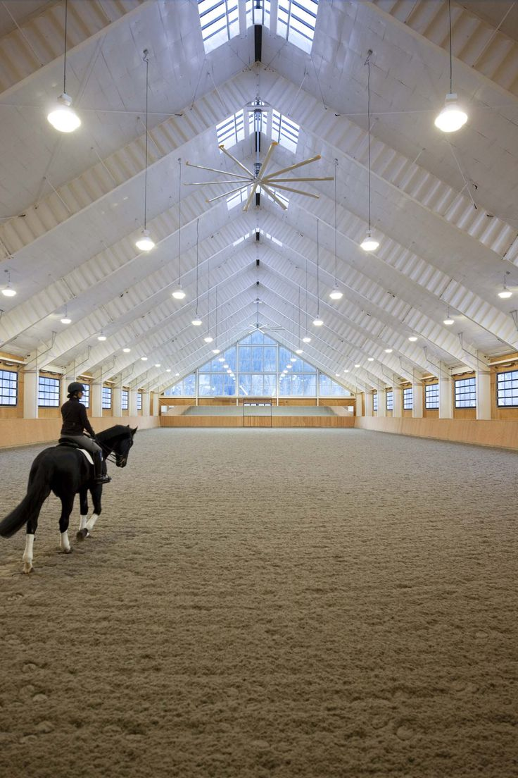 ^We are all envious of this rider riding in the indoor arena at the Riverlands Equestrian Facility designed by GH2 Gralla Equine Architects in British Columbia. Photo credit to: Ivan Hunter Photography