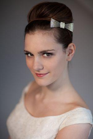 beehive bridal hairdo with silver bow headband