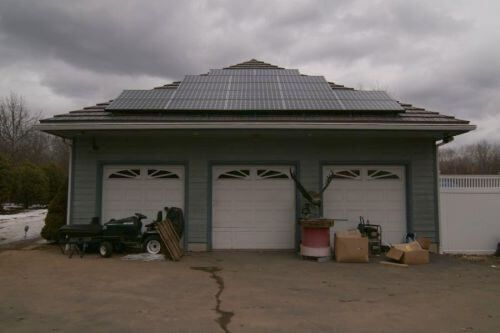 Solar panels on a metal roof with rustic shake shingles #rusticshake #MetalRoofs