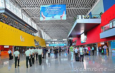 Marching guards and visitors at the entrance of hall 6.1 of Canton fair at Guangzhou, China.