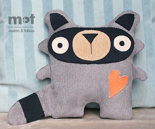 Raccon from mateoandtobias's etsy shop.  Love the use of the herringbone fabric.