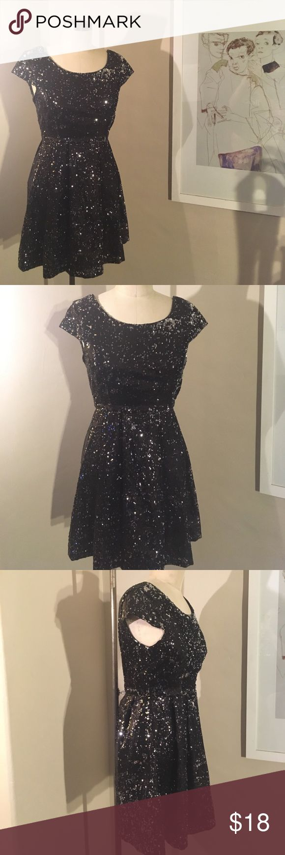 Sequined Open-Back Dress Super sparkly sequined black dress. This little number is perfect for a night out. Sequins are in good condition. It's a Forever 21 dress so it does run a little short and small. Only worn once. Forever 21 Dresses Backless