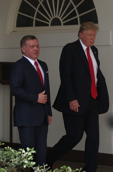 U.S. President Donald Trump (L) and King Abdullah II (R) of Jordan walk through the White House West Colonnade after a joint news conference April 5, 2017 in Washington, DC. President Trump held talks on Middle East peace process and other bilateral issues with King Abdullah II.
