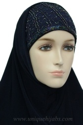 OUR HANDMADE TWO PIECE AL AMIRA HIJAB CONSISTS OF BONNET AND BUKNUK IN NAVY   BONNET HAS AN INSERT ALONG THE FRONT WHICH IS EMBROIDERED WITH NAVY BEADS AND SEQUINS   BONNET HAS ELASTIC IN THE BACK WHICH CAN BE ADJUSTED FOR THE PERFECT FIT   LARGER THEN STANDARD AMIRA HIJABS