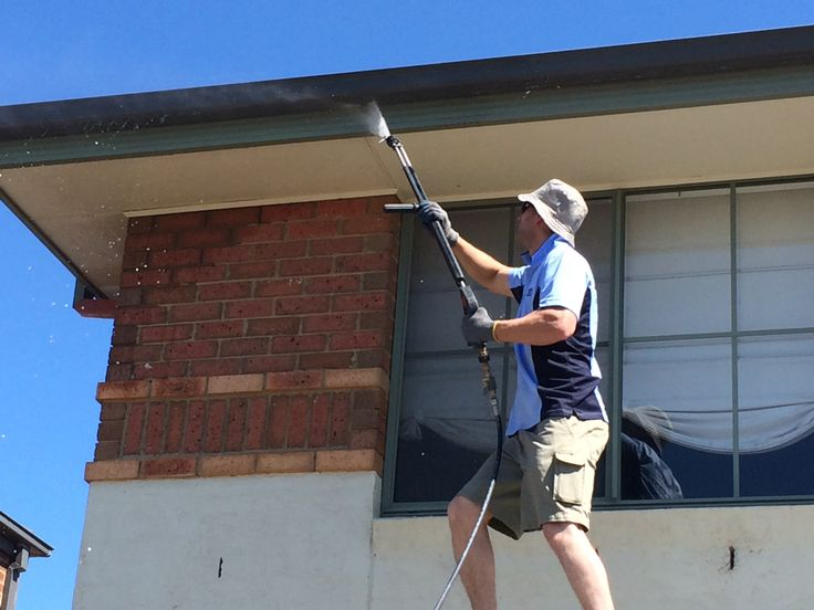 Washing a brick- veneer house. We wash from the top to the bottom and follow up by cleaning the windows.