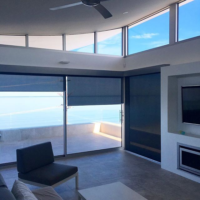 Oriental pure blockout roller blinds with charcoal sunscreen roller blinds and a silver powder coated Aluminium facia concealing all the brackets and tubes for a refined finish. #rollerblinds #blinds #livingroom #facia #pelmet #baileyblinds #adelaide #sou