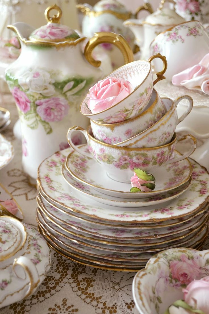 Sweet light pink roses antique teacups and teapots and plates, oh my!  Jennelise blog