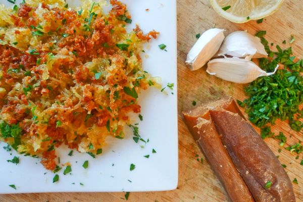 Bottarga Squash: Ingredients ― 1 spaghetti squash; ¼ c extra virgin olive oil; 1 garlic clove; 5 oz grated bottarga; 3 Tbsp chopped parsley; 2 tsp lemon zest. Instructions ― Roast squash in 375° F oven; 45 minutes. Cut squash in half, scoop out the seeds, and separate the strands with a fork. Heat olive oil and garlic for a few minutes. Add grated bottarga and mix into the olive oil. Add the squash, parsley, and lemon zest to skillet and toss. Serve. #Bottarga #Squash #realfooddigest