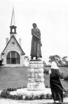 Longfellow's Evangeline statue in front of Acadian church - Nova Scotia, Canada.