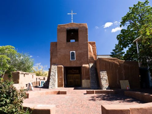 NEW MEXICO: SAN MIGUEL MISSION  While driving through New Mexico, make sure to pull off in Santa Fe to see America's oldest known church, which was built between approximately 1610 and 1626.     - pmphoto/Shutterstock