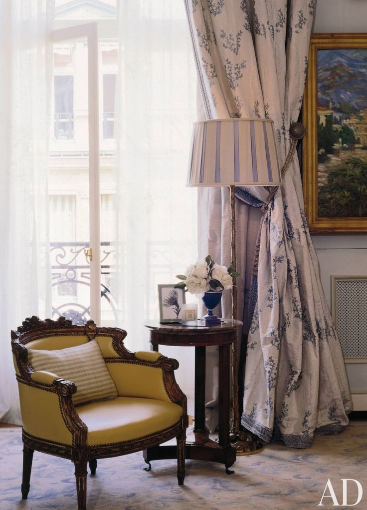 Traditional Bedroom by Timothy Corrigan and Timothy Corrigan in Paris, France. Blue rug